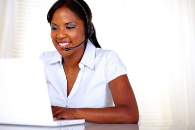Women with headset on laptop