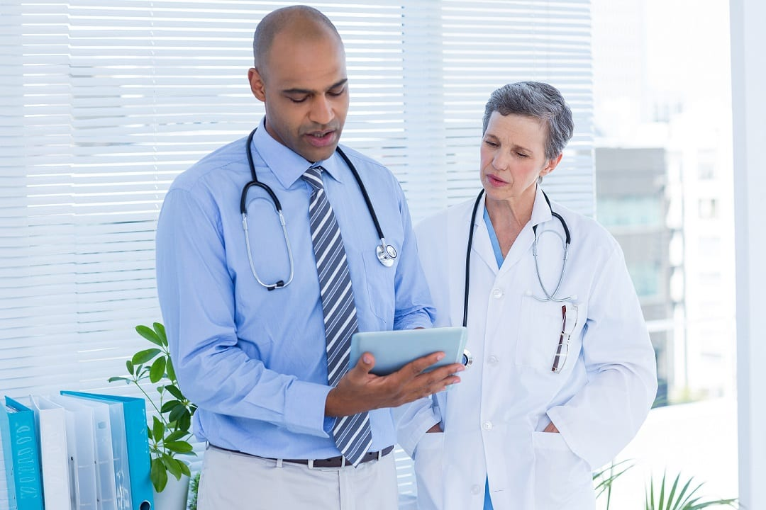 Two Doctors looking at a chart together