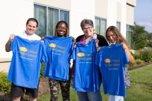 Employees with Two Millionth Shirt