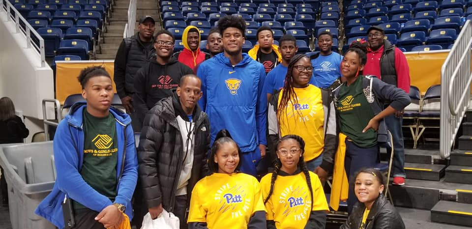 boys and girls clubs of rochester members at a basketball game