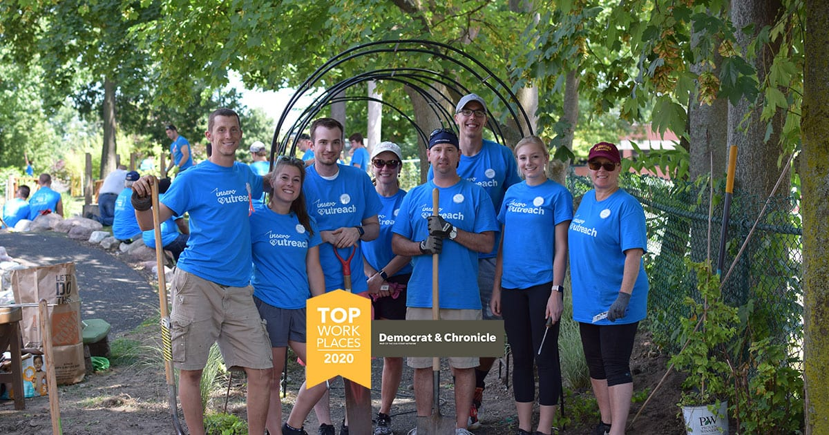 Rochester Top Workplaces 2020 logo over a team photo from Insero's first Volunteer Day