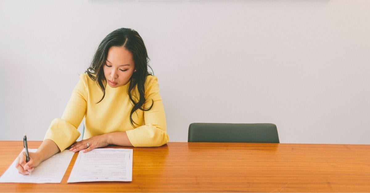 how to make job interviews matter, woman in yellow shirt prepares for job interview