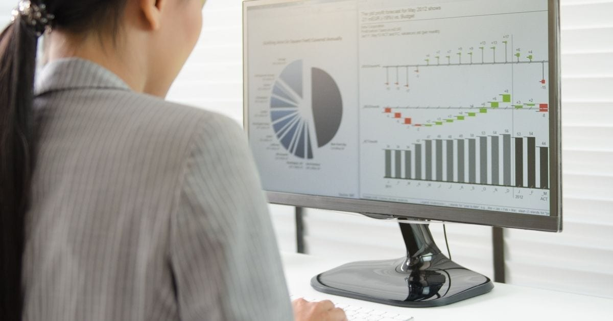 woman on computer with graphs representing segregation of duties